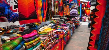 View of stalls in traditional ethnic craft market, Ecuador